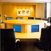 Conference Table, freestanding: natural white ash with hydraulically lifted turr