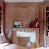Paneled Room, built-in: pickled oak with hand carved cartouches.