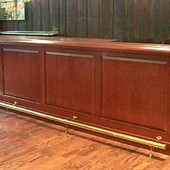 Bar, built-in: brass, stained mahogany.