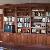 Bookcase/Storage Cabinet, built-in: stained knotty pine.