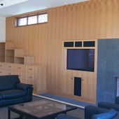 Bookcase, decorative paneling and fireplace surround:  Natural anigre.