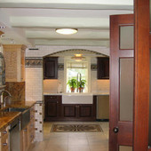 Kitchen, built-in: granite, mahogany, quilted and natural maple
