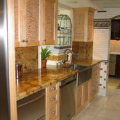 Kitchen, built-in: granite, quilted and natural maple
