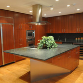 Boat shaped kitchen island designed by Ginger Woods LLC. Ribbon-striped mahogany and brushed aluminum.