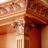 Bookcase (detail), built-in: antiqued maple with carved accents.